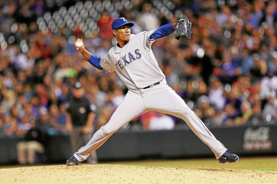 The Boston Red Sox have signed former Texas Rangers reliever Alexi Ogando. Photo: David Zalubowski — The Associated Press File Photo  / AP