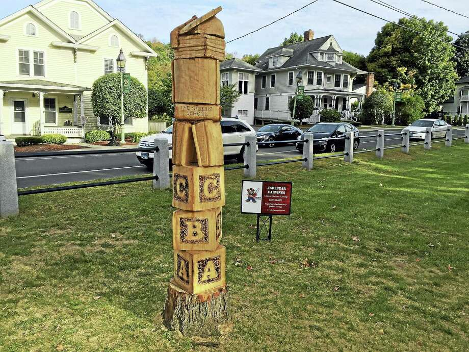 Ben Lambert - The Register Citizen  Jason Welcome's carved tribute to the Winchester educational system was recently  completed in East End Park. Photo: Journal Register Co.