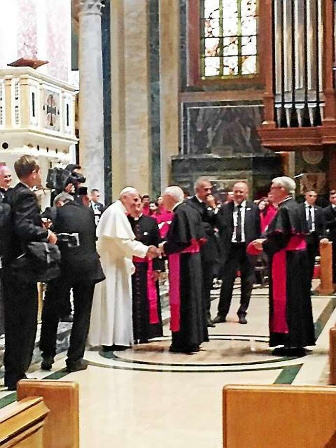 Archbishop Leonard P. Blair of the Archdiocese of Hartford being presented to Pope Francis at the Cathedral of St. Matthew the Apostle in Washington, D.C. during the Popeís meeting with U.S. bishops last Wednesday. Photo: (Archdiocese Of Hartford)