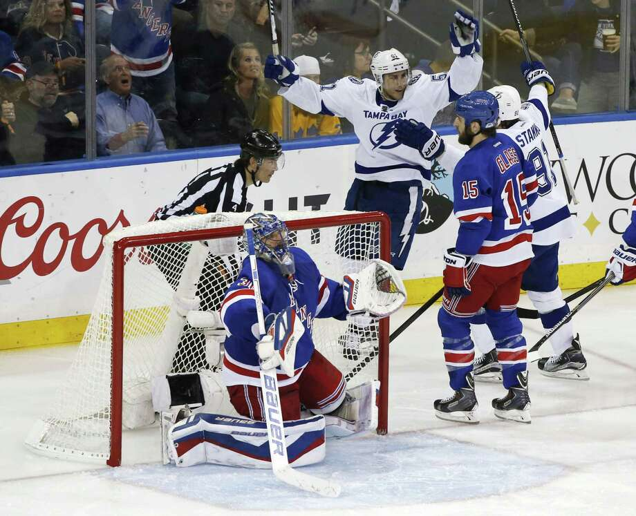 Tampa Bay Lightning center Valtteri Filppula (51) and center Steven Stamkos (91) celebrate a third-period goal by Alex Killorn in their 2-0 win over the Rangers in Game 7 of the Eastern Conference final. Photo: Kathy Willens  — The Associated Press  / AP