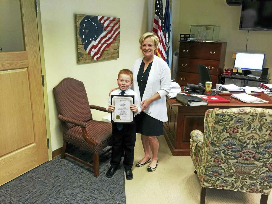 BEN LAMBERT — The Register CitizenLiam Hayes, a second-grader at St. Peter/St. Francis, was named the Torrington Mayor for the Morning Tuesday. Photo: Journal Register Co.