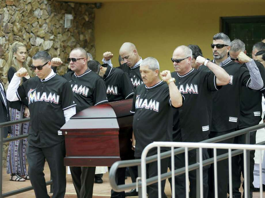Pallbearers wearing Miami Marlins jerseys carry the casket of Miami Marlins pitcher Jose Fernandez, after a memorial service at St. Brendan's Catholic Church, Thursday in Miami. Photo: Lynne Sladky — The Associated Press  / AP