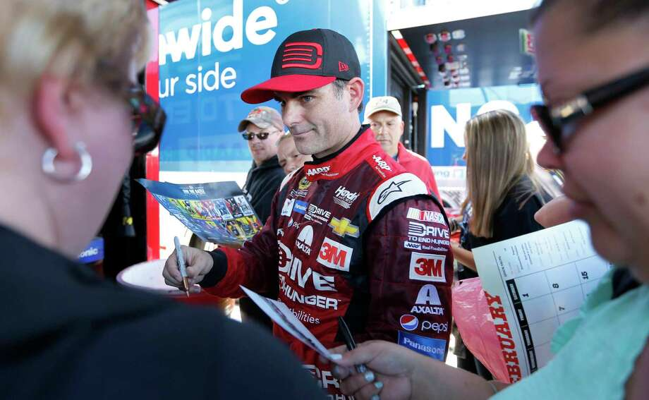 Jeff Gordon signs autographs for fans on Saturday. Photo: Jim Cole — The Associated Press  / AP
