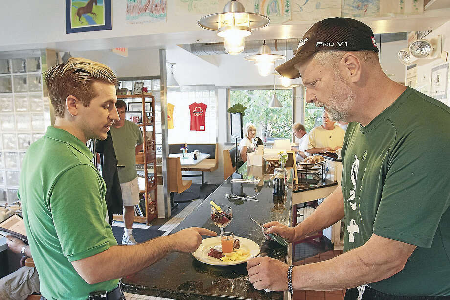 "photo by Tom HopkinsDerek Trafton, left, O'Rourke's manager with Brian O'Rourke, owner and author of ""Breakfast at O'Rourke's."" Photo: Journal Register Co."