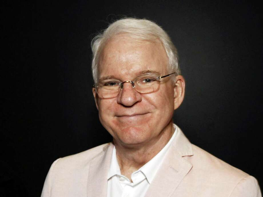 "FILE - In this June 23, 2014 file photo, Steve Martin poses during ""The Un-Private Collection: Eric Fischl and Steve Martin,"" an art talk presented by The Broad museum in Santa Monica, Calif. Martin will receive the American Film Instituteís 43th Life Achievement Award at a private ceremony on June 4, 2015, in Hollywood.  (Photo by Ryan Miller/Invision/AP, File) Photo: Ryan Miller/Invision/AP / Invision"