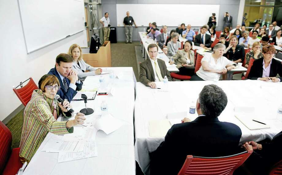 (Arnold Gold-New Haven Register)  U.S. Rep. Rosa DeLauro (far left) speaks at a discussion about the federal government's cancer moonshot initiative at the Yale West Campus in Orange on 5/31/2016. Photo: Journal Register Co.