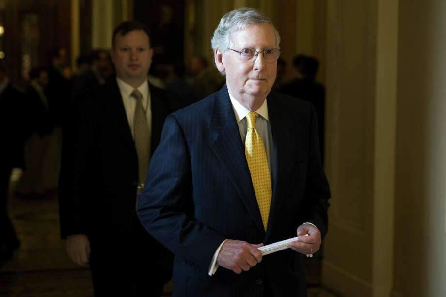 Senate Majority Leader Sen. Mitch McConnell walks to his office on Capitol Hill in Washington. Photo: AP Photo  / AP