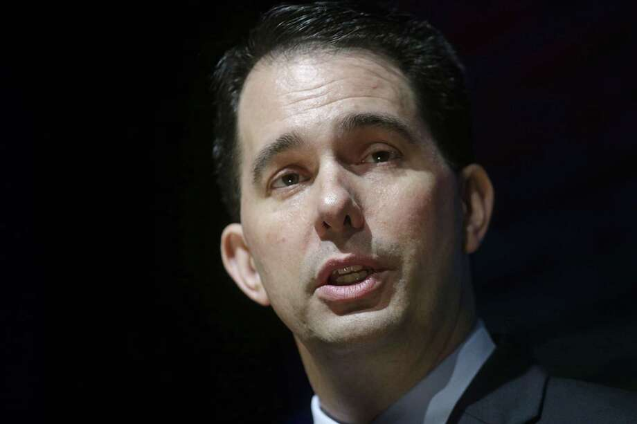 In this May 18 photo, Wisconsin Gov. Scott Walker speaks to the American Federation For Children in New Orleans. Photo: Ap Photo  / AP