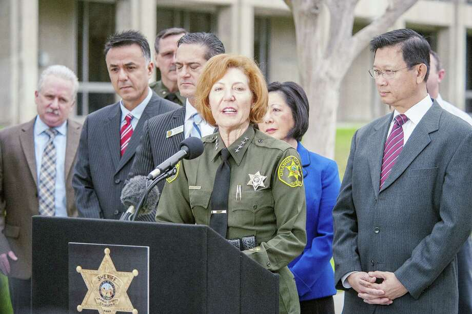 Orange County Sheriff Sandra Hutchens announces the capture of both outstanding jail escapees Hossein Nayeri and Jonathan Tieu are in the custody of the San Francisco during a news conference outside Orange County Sheriff's Department headquarters in Santa Ana on Saturday, Jan. 30, 2016. (Ken Steinhardt/The Orange County Register via AP) Photo: AP / The Orange County Register