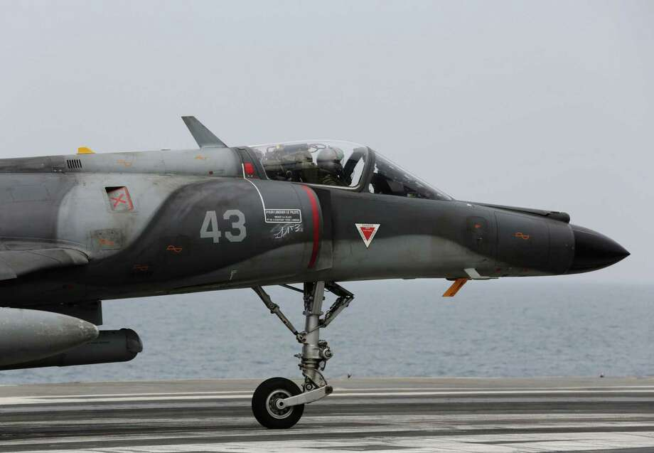 In this March 18, 2015 photo, a French military plane lands on the French navy aircraft carrier Charles de Gaulle in the Persian Gulf. Photo: AP Photo/Hasan Jamali, File  / AP