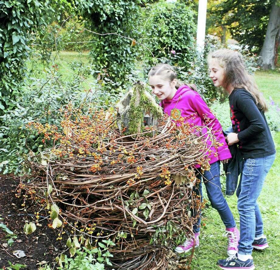 Children enjoy a Wee Faerie Village scene. Photo: Contributed
