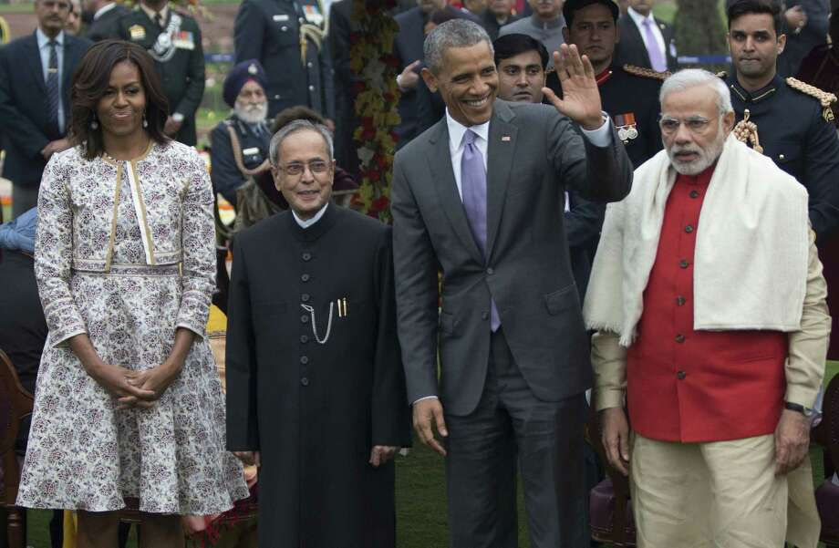President Barack Obama, second from right, first lady Michelle Obama, left, Indian Prime Minister Narendra Modi, right, and Indian President Pranab Mukherjee pose for photographers during a reception in the Mughal Gardens at the Rashtrapati Bhavan presidential palace in New Delhi, India, on Jan. 26. Photo: AP Photo  / AP
