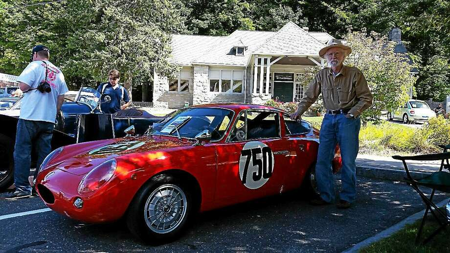 N.F. Ambery photo Mahlon F. Craft showed off his red 1963 Abarth 1100 GT Sunday. Photo: Journal Register Co.