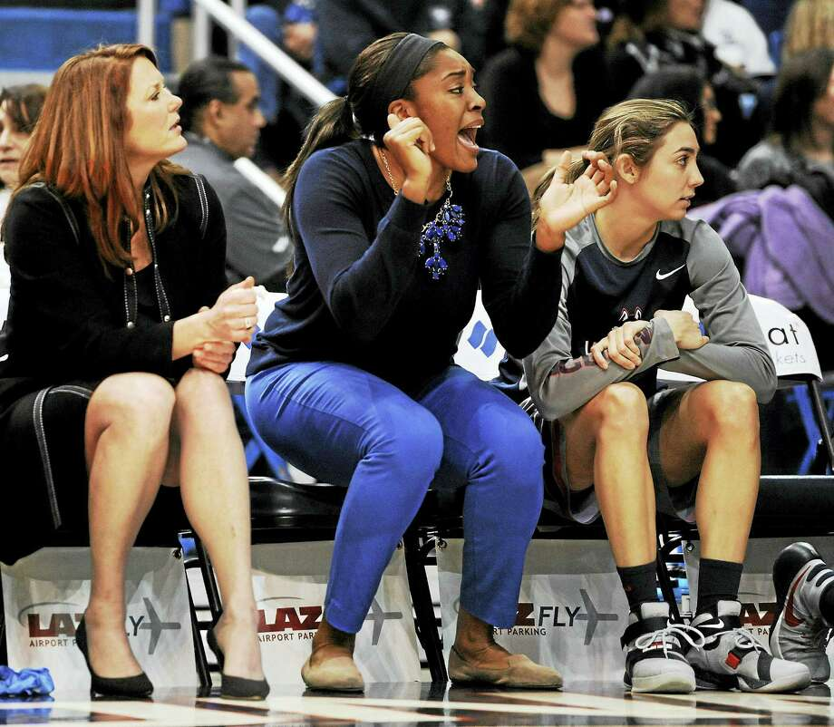 UConn's Morgan Tuck, center, cheers on teammates from the bench during a recent game. Photo: The Associated Press File Photo  / FR125654 AP