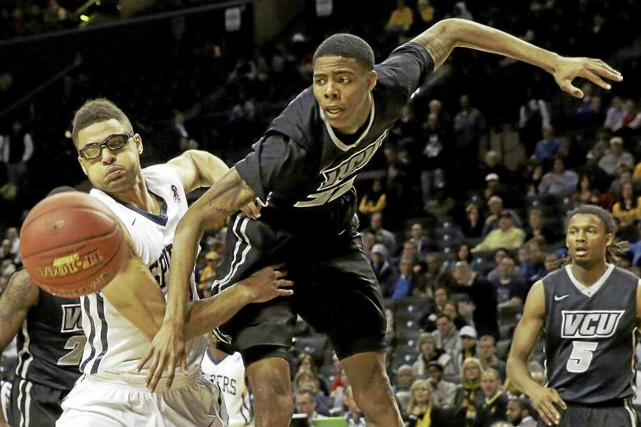 VCU freshman forward Terry Larrier, right, is transferring to UConn. Photo: Mary Altaffer — The Associated Press  / AP