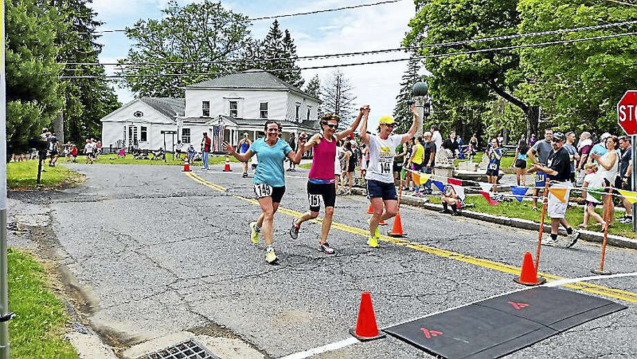 Theresa Simaitis, 51; Jojo Moore, 59; and Berta Andruhs-Mette, 52, all of Litchfield, came in the finish line at the 38th Annual Memorial Day Five-Mile Road Race on Monday afternoon at the Norfolk Village Green in Norfolk. Photo: Photo By N.F. Ambery