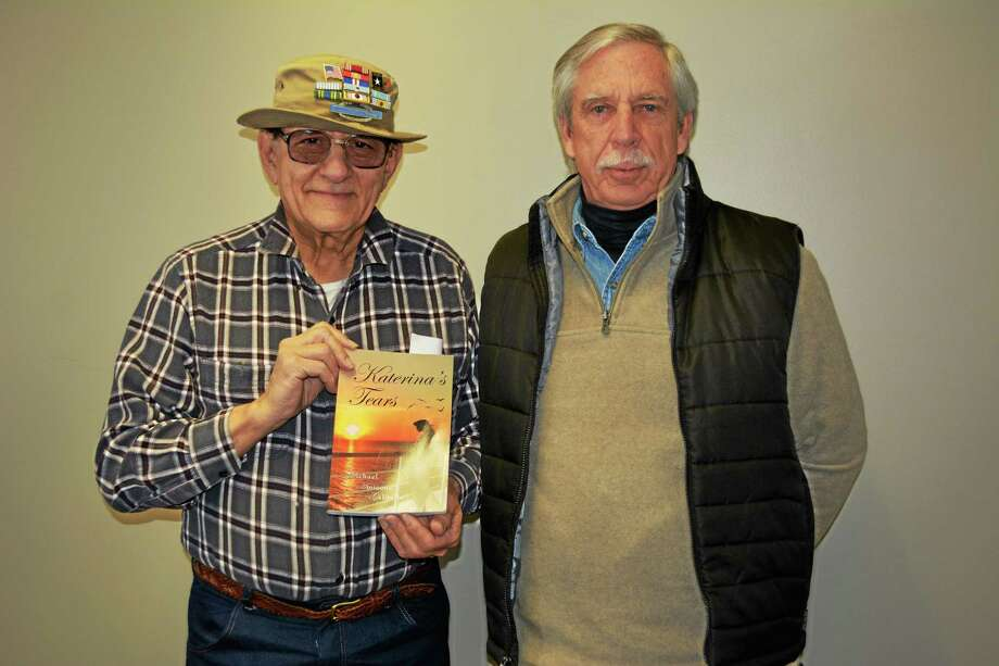 "Michael Galitello, left, with ghost writer Rob Carr on right, and a copy of Galitello's novel, ""Katerina's Tears."" Photo: Amanda Webster — The Register Citizen"