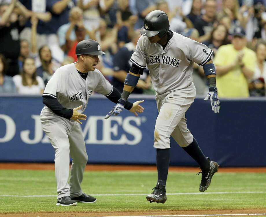 The Yankees' Starlin Castro, right, celebrates with third base coach Joe Espada after hitting a two-run home run in the seventh inning on Sunday. Photo: Chris O'Meara — The Associated Press  / AP