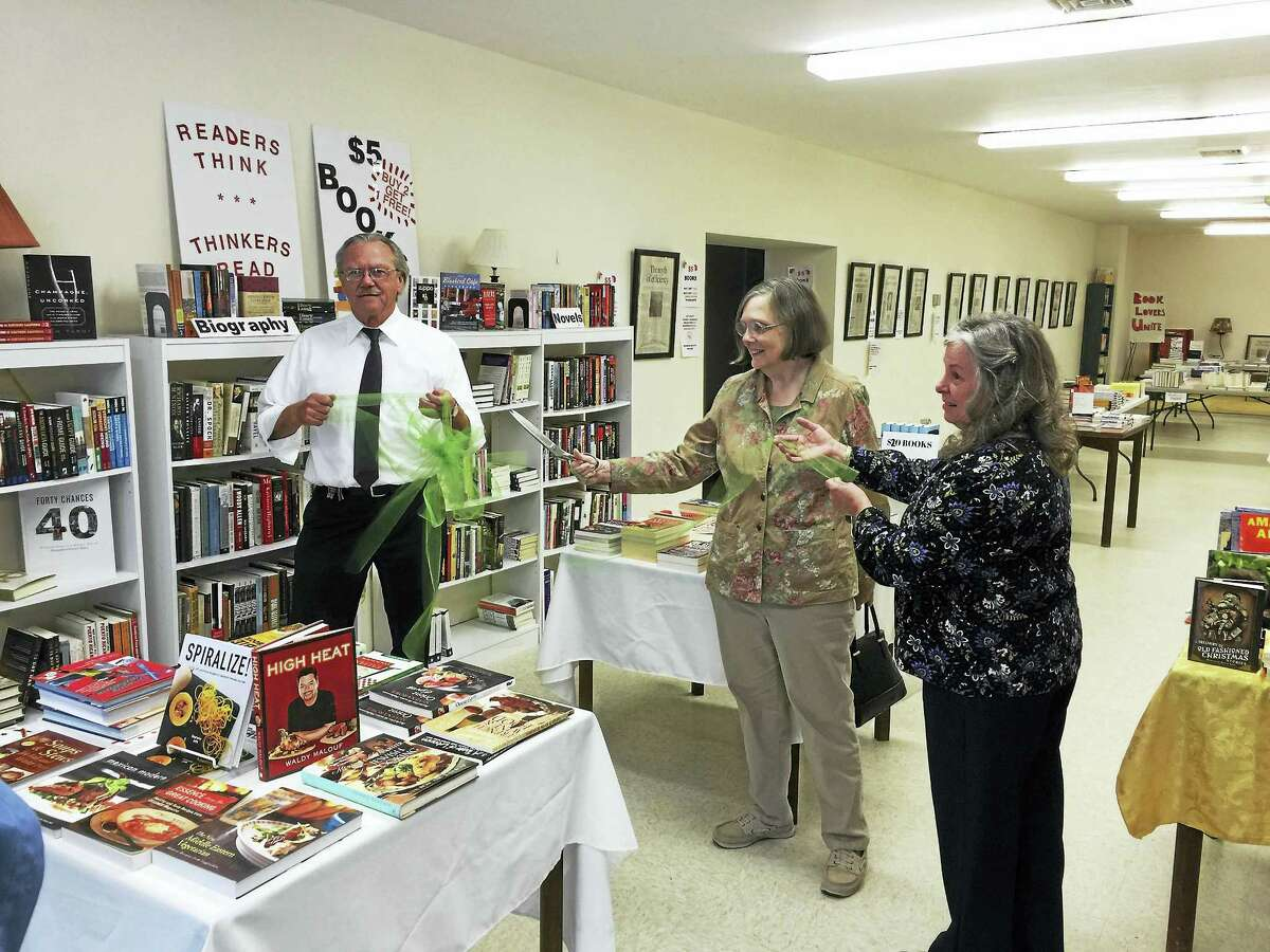 Ben Lambert - The Register Citizen Visitors check the selection of books at the Winsted Community Bookstore during its opening on Thursday.
