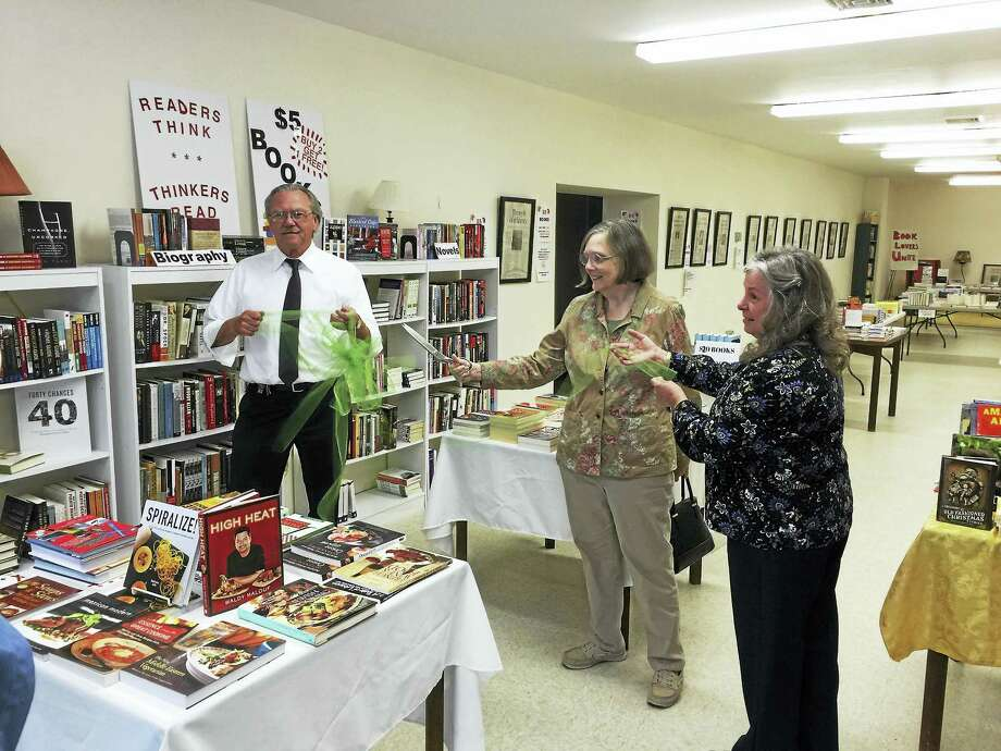 Ben Lambert - The Register Citizen Visitors check the selection of books at the Winsted Community Bookstore during its opening on Thursday. Photo: Journal Register Co.