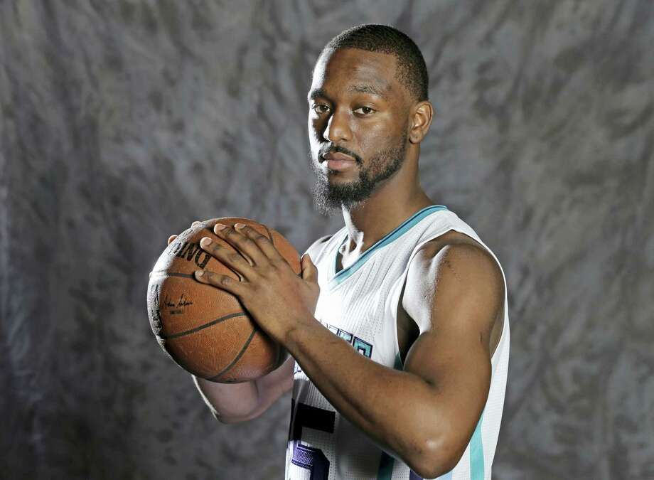 In this photo taken Sept. 26, 2016, Charlotte Hornets' Kemba Walker poses for a photo during the NBA basketball team's media day in Charlotte, N.C. Walker has been on the verge of becoming an NBA All-Star. Nicolas Batum and other teammates believe this will be the year the sixth-year pro finally breaks through. (AP Photo/Chuck Burton) Photo: AP / Copyright 2016 The Associated Press. All rights reserved.