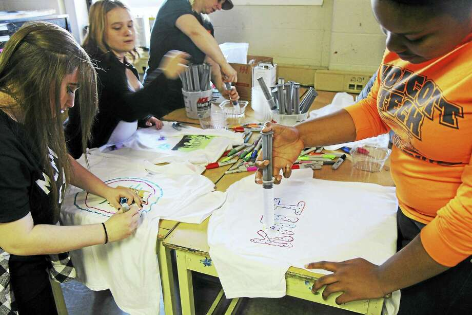 Contributed photos Oliver Wolcott Tech students decorate t-shirts for guests at the annual art show, held May 12. Photo: Journal Register Co.