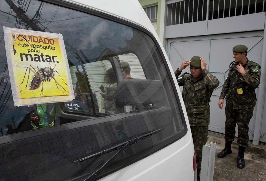 """Army soldiers prepare for a clean up operation against the Aedes aegypti mosquito, which is a vector for transmitting the Zika virus, in Sao Paulo, Brazil, Thursday, Jan. 28, 2016. The sticker reads in Portuguese """"Beware, this mosquito can kill."""" Photo: AP Photo/Andre Penner   / AP"""