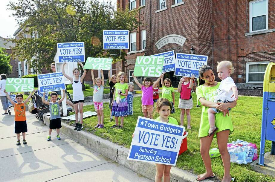 A group of Winchester residents rally in front of City Hall Friday, urging others to support the proposed budget. Voters approved the 2016-17 budget Saturday. Photo: CONTRIBUTED PHOTO