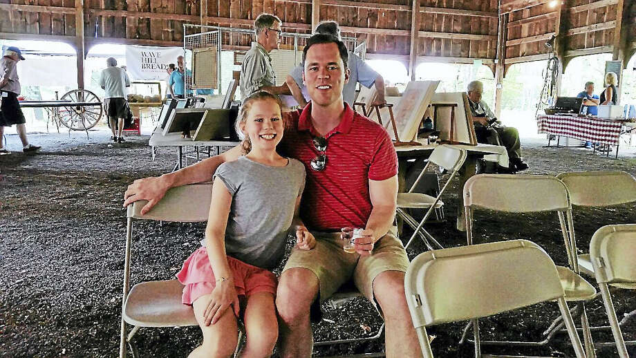 Joseph Camm and daughter Cecilia, 10, both of Boston, attended the second annual Farm Art Festival at the theater pavilion at the Abbey at Regina Laudis at 249 Flanders Road in Bethlehem on Saturday afternoon. Photo: N. F. Ambery