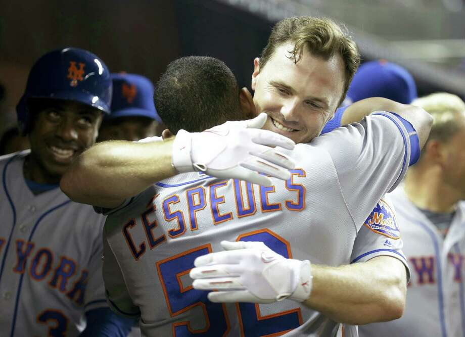 New York's Jay Bruce hugs Yoenis Cespedes (52) after hitting a two-run home run in the fifth inning against the Miami Marlins Wednesday. The Mets won 5-2. Photo: LYNNE SLADKY — THE ASSOCIATED PRESS  / Copyright 2016 The Associated Press. All rights reserved.