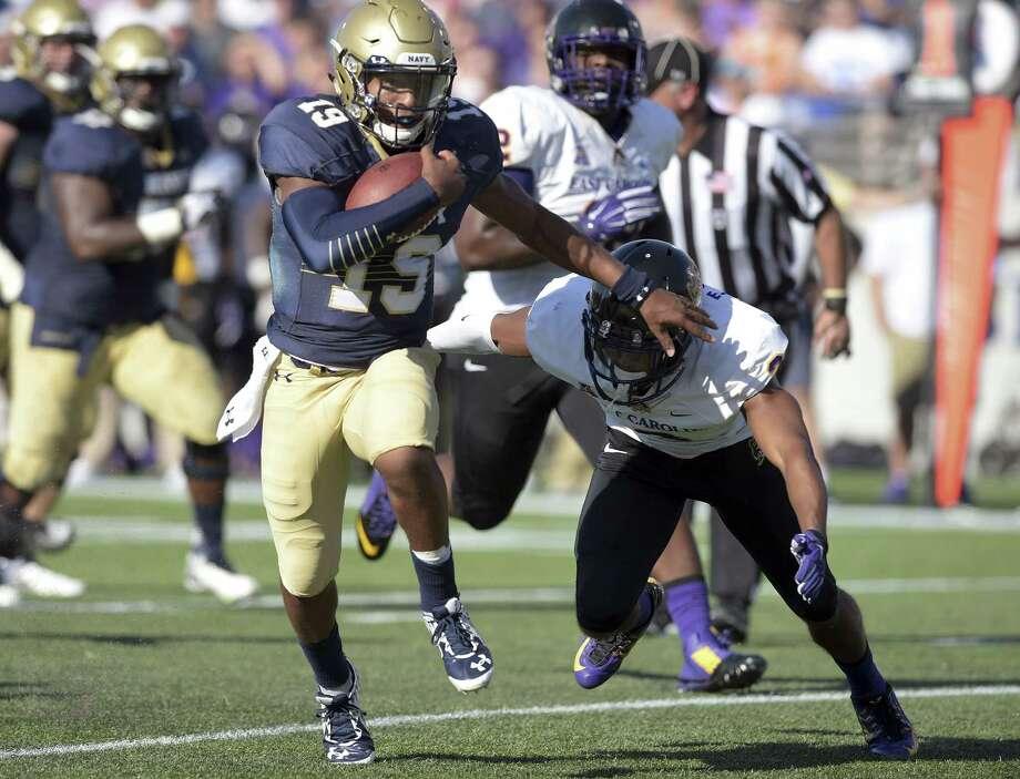 Navy quarterback Keenan Reynolds runs for a long gain against East Carolina earlier this season. Photo: The Associated Press File Photo  / Capital Gazette