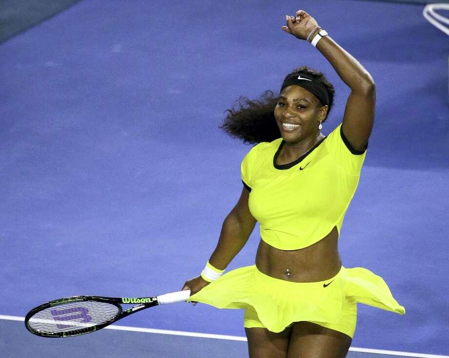 Serena Williams celebrates after defeating Agnieszka Radwanska during their semifinal match at the Australian Open Thursday. Photo: The Associated Press  / AP