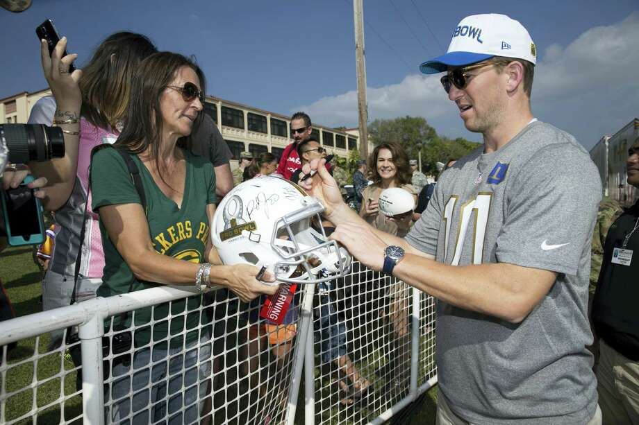 New York Giants quarterback Eli Manning signs autographs before the NFL Pro Bowl football draft at Wheeler Army Airfield, Wednesday, Jan. 27, 2016, in Wahiawa, Hawaii. (AP Photo/Marco Garcia) Photo: AP / FR132415 AP
