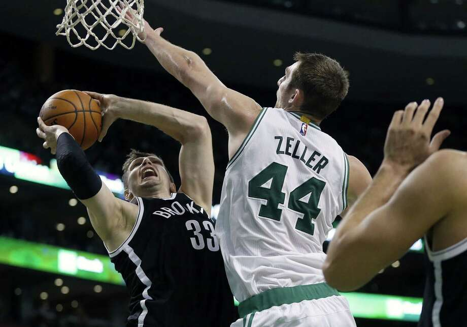 The Celtics' Tyler Zeller blocks a shot by the Brooklyn Nets' Mirza Teletovic during a Dec. 26 game in Boston. Photo: Michael Dwyer — The Associated Press  / AP