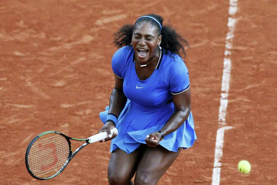 Serena Williams clenches her fist in the third set of her match against Kristina Mladenovic at the French Open on Saturday. Photo: Christophe Ena — The Associated Press  / AP