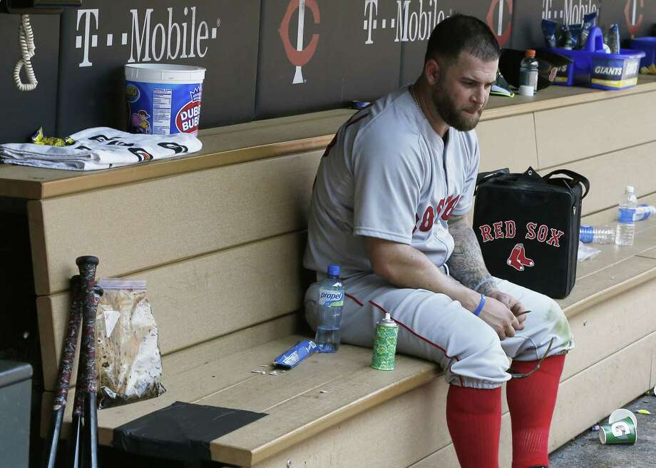 Boston first baseman Mike Napoli sits alone in the dugout after the Minnesota Twins beat the Red Sox 6-4 on Wednesday in Minneapolis. Photo: Jim Mone — The Associated Press  / AP