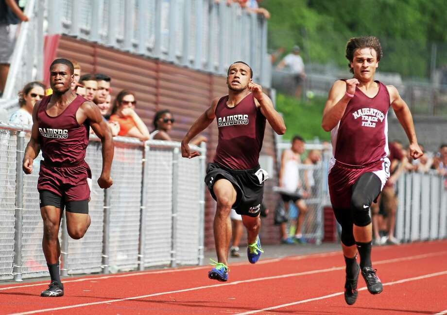 Naugatuck's Keyon Robinson, center, races to the finish line in the 100 meter dash to finish sixth. Teammate Dylan Myrie, left, was seventh. Photo: Marianne Killackey — Register Citizen  / 2015