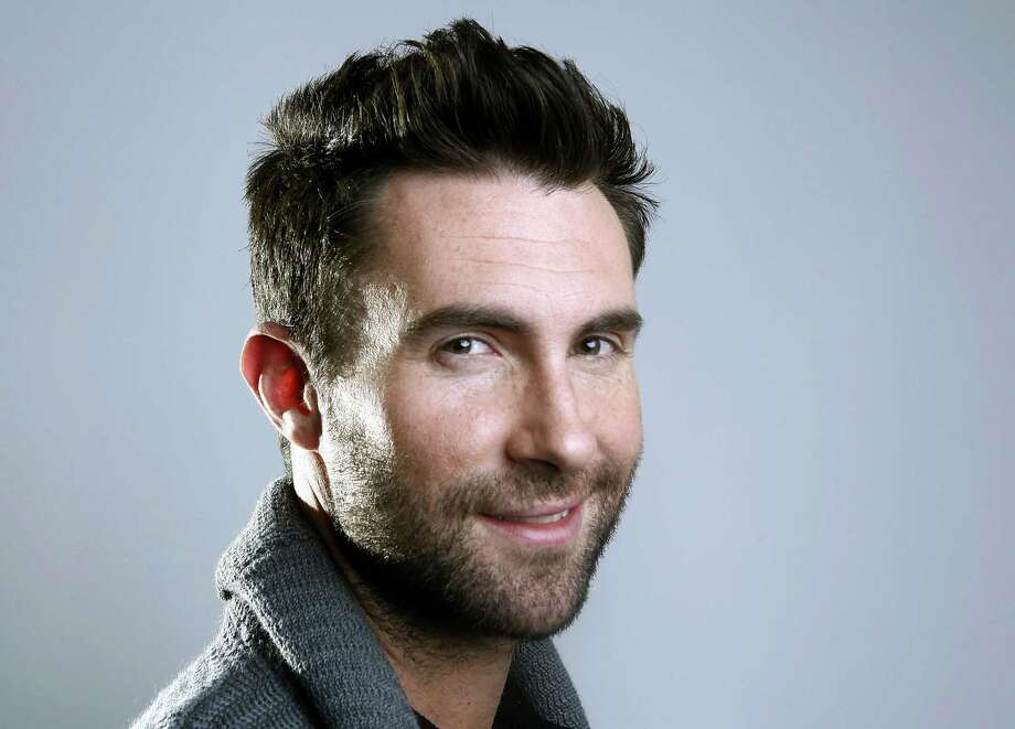 FILE - This Feb. 20, 2012, file photo shows Maroon 5 frontman Adam Levine in New York. The Grammy Awards will feature a number of collaborative performances, including Lady Gaga with Tony Bennett and Levine with Gwen Stefani. The Recording Academy said Tuesday, Jan. 27, 2015, that Annie Lennox will also be paired with newcomer Hozier and Jessie J with Tom Jones at the Feb. 8 show in Los Angeles. (AP Photo/Carlo Allegri, File) Photo: AP / R-Allegri
