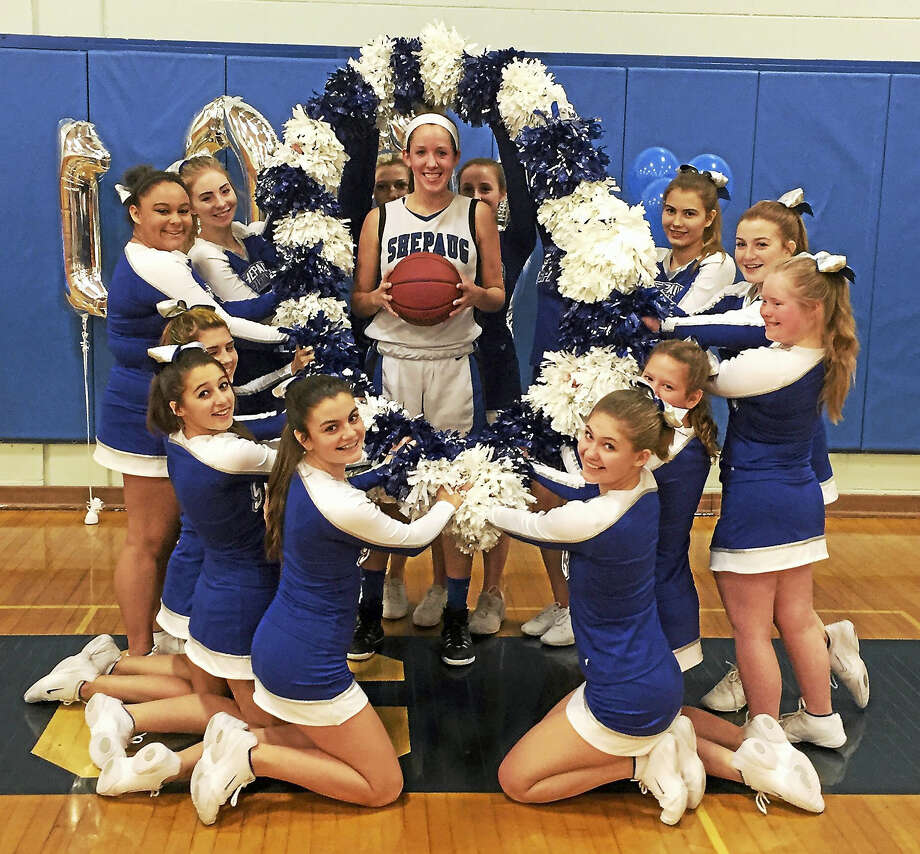 Photo courtesy of Shepaug High SchoolShepaug's cheerleaders help Caroline Kelly celebrate her 1,000th career point in a loss to Lewis Mills at home Tuesday evening. Kelly scored 15 points to go one over the mark. Photo: Journal Register Co.