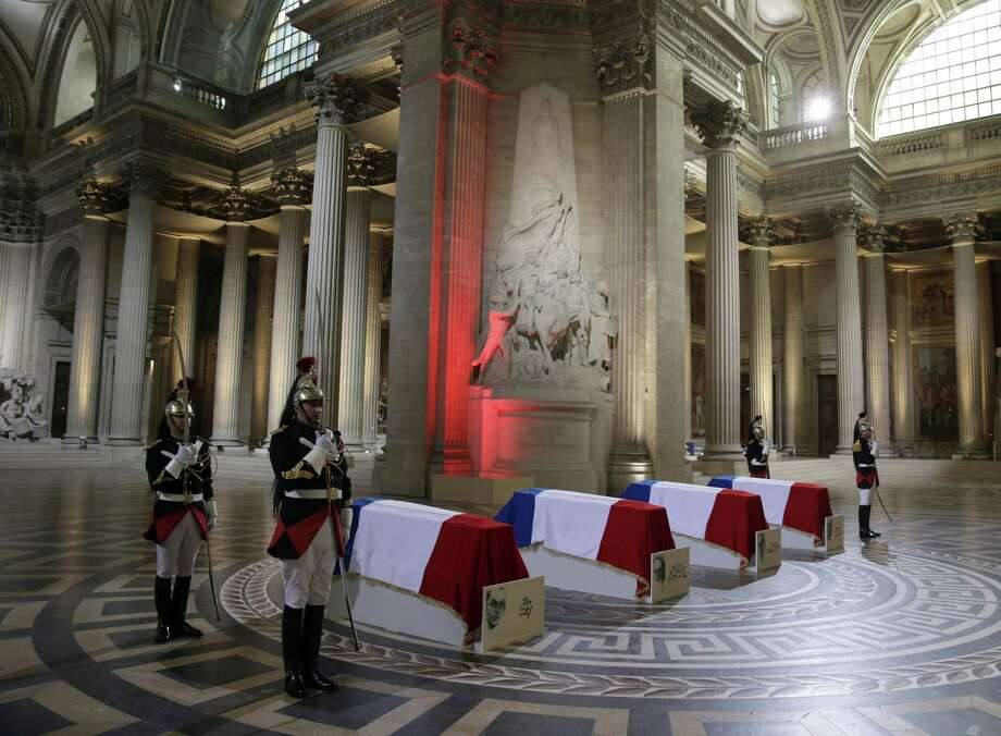 Four flag-draped coffins are seen inside the Pantheon as part of an induction ceremony in Paris, France, Wednesday, May 27, 2015. France is honoring four people who resisted the Nazis during World War II by inducting them into Paris' Pantheon mausoleum, in a rare and highly symbolic ceremony aimed at uniting the French against extremism and anti-Semitism. The French resistance figures are Pierre Brossolette, Germaine Tillion, Genevieve de Gaulle-Anthonioz and Jean Zay. (Philippe Wojazer/Pool Photo via AP) Photo: AP / Reuters Pool