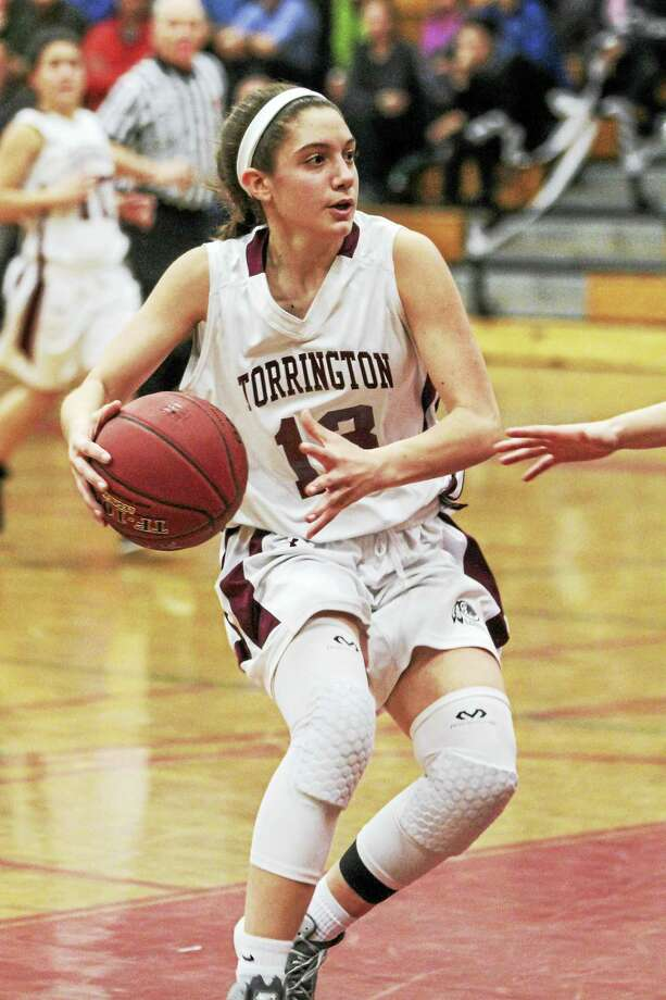 Torrington's Brie Pergola, still not 100 percent after sitting out with a muscle strain a few weeks ago, was a steadying force for the young Red Raider team. Photo: Marianne Killackey — For Register Citizen  / 2015