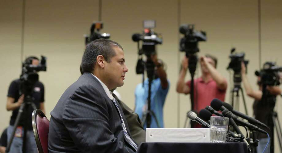 Jay High School head football coach Gary Gutierrez testifies before the University Interscholastic League (UIL) State Executive Committee, Thursday in Round Rock, Texas.  The school's principal and Gutierrez told the UIL, the governing body for high school sports in Texas, they believe assistant coach Mack Breed told players to retaliate against an official in the closing minutes of a game earlier this month. Photo: The Associated Press  / AP