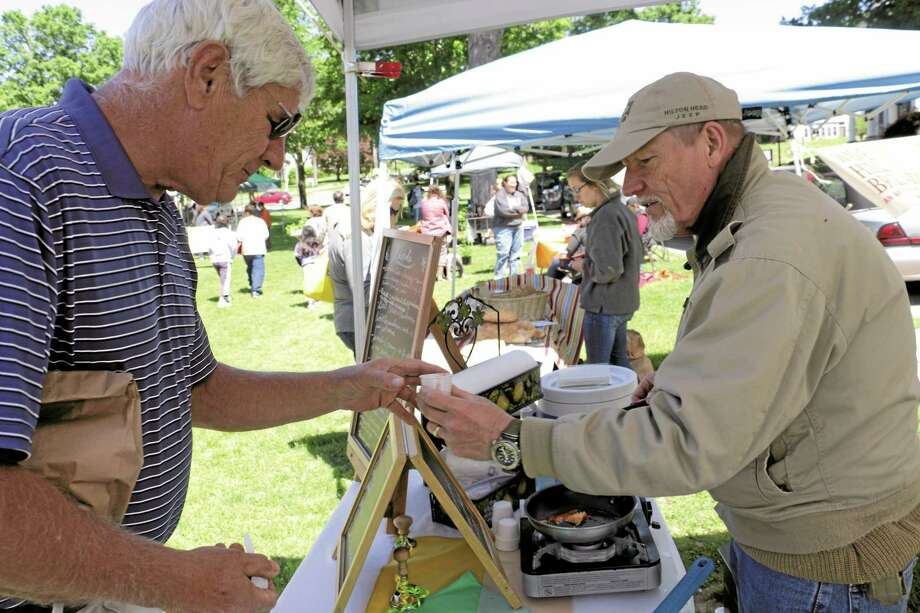 Jim Herberick of New Milford takes a sampling from Robert Tantillo of Fresh Pastabilities, which is based in Redding. Photo: John Fitts — The Register Citizen
