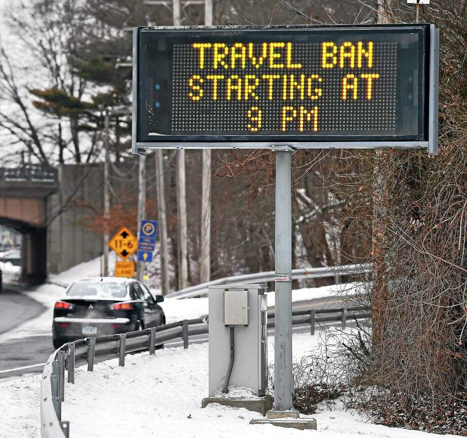 (Arnold Gold-New Haven Register)  A neon sign advertises a travel ban at the entrance to the Milford Connector to Rt. 15 in Milford on 1/26/2015. Photo: Journal Register Co.