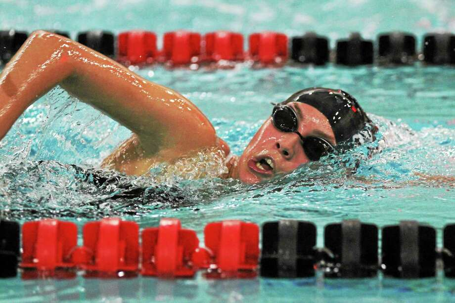 Jen Friscia of Torrington takes first place in the 500-yard freestyle. Photo: MARIANNE KILLACKEY — REGISTER CITIZEN  / 2015