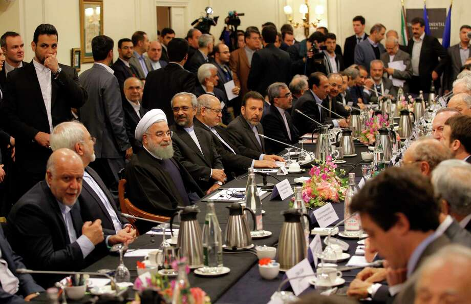 """Iranian President Hassan Rouhani, third left seated, attends a meeting with French Economy Minister Emmanuel Macron and French business leaders in Paris, Wednesday, Jan. 27, 2016. Rouhani says his first visit to Europe since the nuclear accord was signed has proven that there are """"great possibilities"""" for economic, academic, scientific and cultural cooperation and that """"today we are in a win-win situation"""" after years of mutual losses due to sanctions. Photo: AP Photo/Christophe Ena   / AP"""