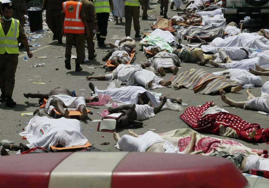 Bodies of people who died in a crush in Mina, Saudi Arabia during the annual hajj pilgrimage, are seen on Thursday, Sept. 24, 2015. Hundreds were killed and injured, Saudi authorities said. The crush happened in Mina, a large valley about five kilometers (three miles) from the holy city of Mecca that has been the site of hajj stampedes in years past. Photo: AP Photo   / AP