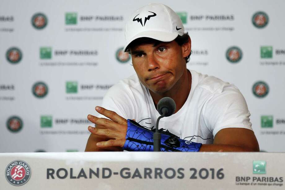 Nine-time champion Rafael Nadal announces he is pulling out of the French Open because of an injury to his left wrist during a press conference at the Roland Garros stadium in Paris, France, Friday May 27, 2016. The left-handed Nadal made the announcement at a hastily arranged news conference Friday, one day before he would have been scheduled to play his third-round match. Photo: Michael Euler — The Associated Press  / AP