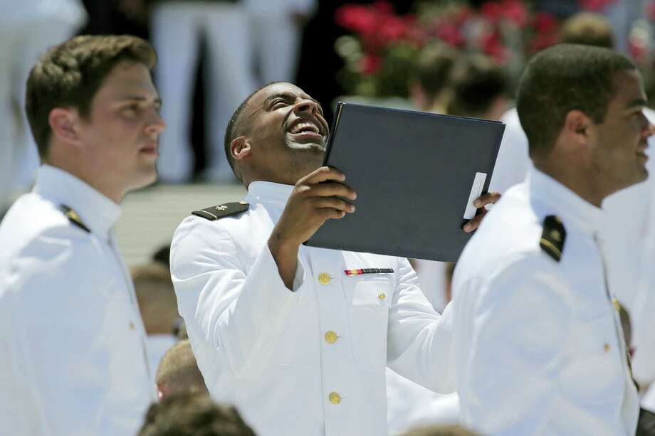 Keenan Reynolds, graduating U.S. Naval Academy Midshipman and the Baltimore Ravens' sixth round NFL draft pick, reacts after receiving his diploma during the Academy's graduation and commissioning ceremony in Annapolis, Md., Friday, May 27, 2016. He will be allowed to defer his service time to play in the NFL. Photo: Patrick Semansky — The Associated Press  / Copyright 2016 The Associated Press. All rights reserved. This material may not be published, broadcast, rewritten or redistribu