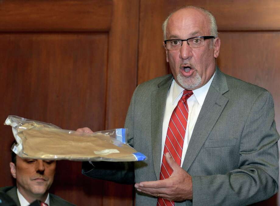 Thomas J. Eoannou, a lawyer for a woman alleging she was sexually assaulted by Chicago Blackhawks forward Patrick Kane, holds up what he says is an empty evidence bag that was improperly left in the doorway of the woman's mother's home, during a news conference, Wednesday, Sept. 23, 2015, in Buffalo, N.Y. Eoannou said the bag at one point contained the rape kit used when the woman reported that she had been assaulted. Photo: AP Photo/Gary Wiepert   / FR170498 AP